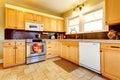 Light tones wood kitchen with brick backsplash design Royalty Free Stock Photo