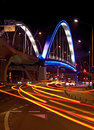 Light trails of cars passing near a bridge in bucharest at night Royalty Free Stock Image