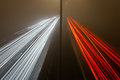 Light trails on the highway at a foggy night Royalty Free Stock Photo