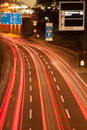 Light trails on the motorway trail of backlights berlin s city at night Royalty Free Stock Photography