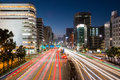 Light trails on the street at dusk in sakae,nagoya city. Royalty Free Stock Photo