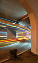 Light trails of a tramway passing under a bridge in bucharest at night Stock Photography
