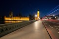 Light trails on westminster bridge from london buses and vehicles with the elizabeth tower big ben of the palace of in the Royalty Free Stock Photography