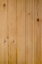 Light wood planking background texture photograph of a panel of tongue and groove shot vertically Stock Photos