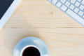 Light Wooden Desk Top View with Business and Every Day Life Items Electronics and Coffee Mug Royalty Free Stock Photo