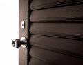 Light and wooden door behind the Royalty Free Stock Photo
