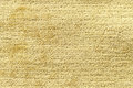 Light yellow background from soft textile material. Fabric with natural texture. Royalty Free Stock Photo