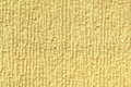 Light yellow fluffy background of soft, fleecy cloth. Texture of textile closeup. Royalty Free Stock Photo