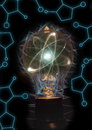 Lightbulb atom particle atomic as filament for nuclear energy imagery Royalty Free Stock Images