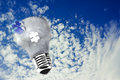 Lightbulb on blue sky, the concept of ecology Stock Image