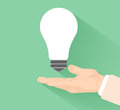 Lightbulb idea concept with hand at flat design and long shadow Stock Photo