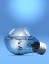 Lightbulb with water incandescent light bulb filled liquid on blue background Royalty Free Stock Image