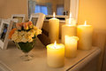 Lighted candles closeup of a on white commode Stock Photo