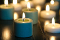 Lighted Candles Glowing in the Darkness Royalty Free Stock Photos