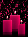 Lighted Christmas Candles Stock Image