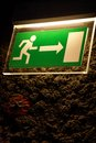 Lighted emergency exit sign in the grotto Royalty Free Stock Photography