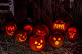 Lighted halloween pumpkins with candles group of candle lit carved in scarey lighting skull in background Stock Images