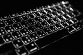The lighted keyboard key board in darkness Stock Image
