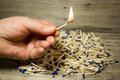 A Lighted Match In His Hand