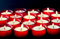 Lighted votive candles Stock Photography