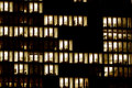 Lighted windows of an office building Royalty Free Stock Photo