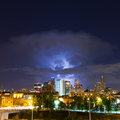 Lightening strike above the denver skyline colorado flashes from a huge cloud colorado during a frequent spring storm across Stock Images