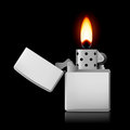 Lighter with flame open metal on black background Royalty Free Stock Photos
