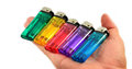 Lighter in hand colorful on white background Royalty Free Stock Photos