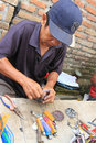 Lighters people receive repair services and charging in sukoharjo central java indonesia Royalty Free Stock Photos