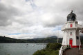 Lighthouse at akaroa the has been rebuilt on the outskirts of the town and is now retired as a working building but it still draws Royalty Free Stock Image