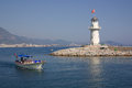 Lighthouse in alanya turkey and boat the port of Stock Image