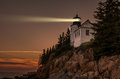 Lighthouse beacon in the night Royalty Free Stock Photo