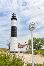 Lighthouse and Birdhouse Royalty Free Stock Photo