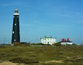 Lighthouse and buildings at Dungeness. UK Royalty Free Stock Photo