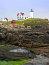 Lighthouse and cape neddick coastline the seacoast near york maine is home to the nubble light a perched upon a small rocky island Royalty Free Stock Photos