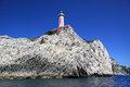 Lighthouse on the cliff capri island italy rocky shore with a Stock Image