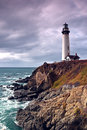 Lighthouse on a cliff and ocean Royalty Free Stock Photography