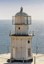 Lighthouse close up of white on sea background Stock Photo