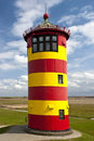 Lighthouse on damm historical at the north sea in pilsum germany to day is used for weddings Royalty Free Stock Images