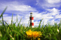 Lighthouse with dandelion, Plymouth, UK Royalty Free Stock Photo