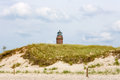 Lighthouse darsser ort at near prerow fischland darss zingst view from the beach Royalty Free Stock Image