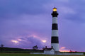 Lighthouse at dawn north carolina s bodie island shining with a colorful sky behind in cape hatteras national seashore Royalty Free Stock Photography