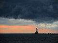 Lighthouse in the distance horizontal at lake michigan Stock Images
