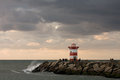 Lighthouse at Dutch coast Stock Photos