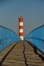 Lighthouse at the end of the bridge Royalty Free Stock Photo