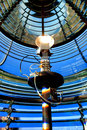 Lighthouse fresnel with guiding beacon light bulb multifaceted glass lens in a maritime navigation aid bright electric used for Royalty Free Stock Photography