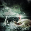 Lighthouse hands storm Stock Image