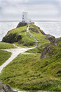 Lighthouse on hill overlooking Irish Sea. Royalty Free Stock Image