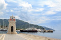 Lighthouse inside the marmaris harbor with marina background Royalty Free Stock Photo