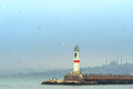 Lighthouse at the jetty in istanbul kadikoy turkey winter evening time Stock Photos